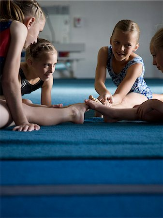 preteen girls stretching - USA, Utah, Orem, Girls (8-11) stretching in gym Stock Photo - Premium Royalty-Free, Code: 640-06050728