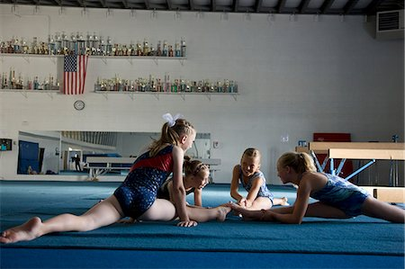 preteen girls stretching - USA, Utah, Orem Girls (8-11) stretching in gym Stock Photo - Premium Royalty-Free, Code: 640-06050729