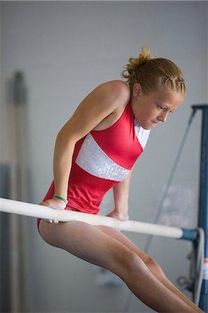 preteen girls stretching - USA, Utah, Orem, girl (10-11) exercising on pole in gym Stock Photo - Premium Royalty-Free, Code: 640-06050735