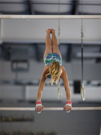 preteen girls stretching - USA, Utah, Orem, girl (10-11) exercising on pole in gym Stock Photo - Premium Royalty-Free, Code: 640-06050736