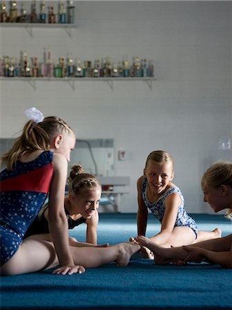 preteen girls stretching - USA, Utah, Orem, girls (8-11) exercising in gym Stock Photo - Premium Royalty-Free, Code: 640-06050730