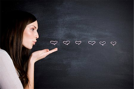 young woman against a chalkboard Stock Photo - Premium Royalty-Free, Code: 640-06051065