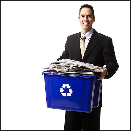 businessperson holding a recycling bin Stock Photo - Premium Royalty-Free, Code: 640-06051170
