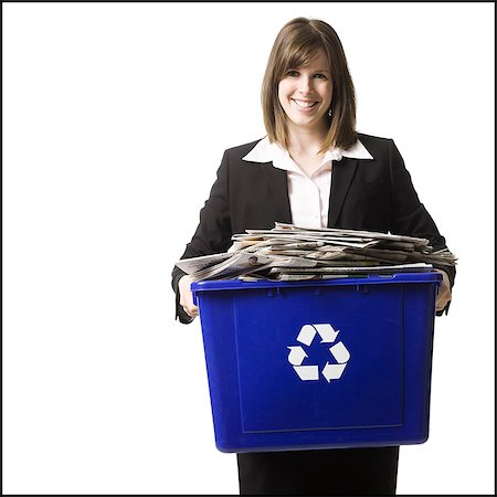 businessperson holding a recycling bin Stock Photo - Premium Royalty-Free, Code: 640-06051172