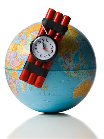 globe with dynamite attached Stock Photo - Premium Royalty-Free, Code: 640-06051271