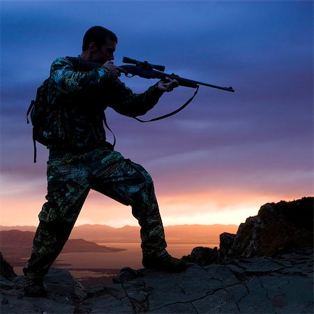 scope - hunter against a sunset Stock Photo - Premium Royalty-Free, Code: 640-06051636