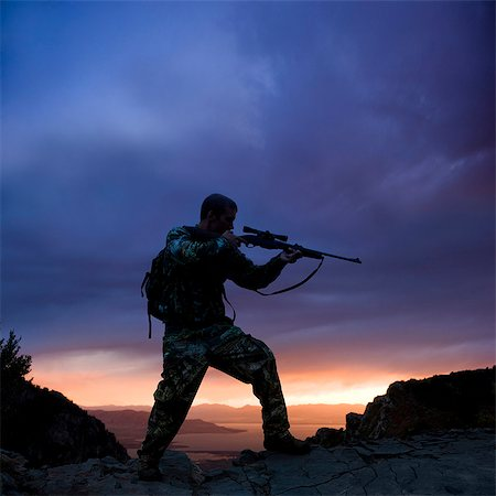 scope - hunter against a sunset Stock Photo - Premium Royalty-Free, Code: 640-06051637