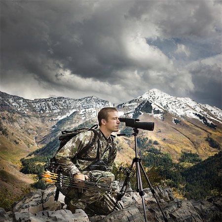 scope - hunter using binoculars to spot prey Stock Photo - Premium Royalty-Free, Code: 640-06051632