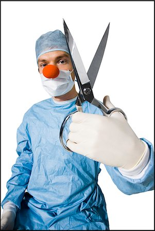 surgeon wearing a creepy clown nose and holding scissors Stock Photo - Premium Royalty-Free, Code: 640-06051647
