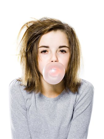 girl with a messy appearance popping a bubble gum bubble Stock Photo - Premium Royalty-Free, Code: 640-06051704