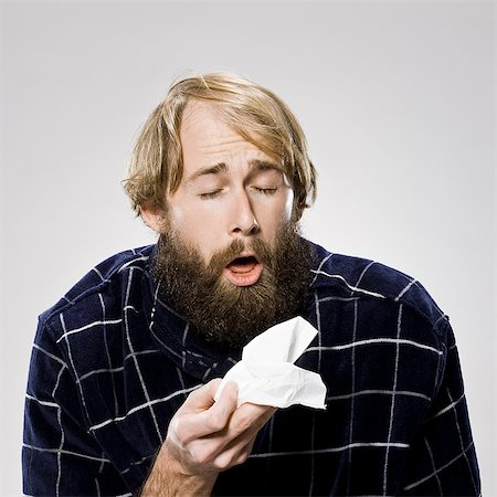 people coughing or sneezing - bearded man with a cold wearing a robe Stock Photo - Premium Royalty-Free, Code: 640-06051735