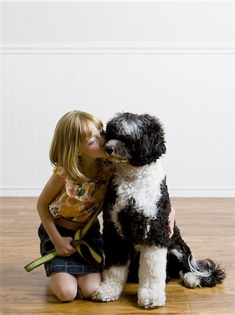 dog kissing girl - girl and her dog Stock Photo - Premium Royalty-Free, Code: 640-06052042