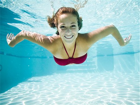 teenage girl in a bathing suit swimming in a pool Stock Photo - Premium Royalty-Free, Code: 640-06052113