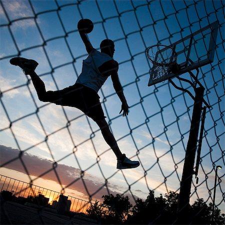 USA,Utah,Salt Lake City,Basketball player slam dunking ball Stock Photo - Premium Royalty-Free, Code: 640-06052207