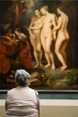 France, Paris, Woman watching paintings in Louvre Museum Stock Photo - Premium Royalty-Free, Code: 640-06963094