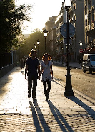 France, Paris, Young couple walking in street Stock Photo - Premium Royalty-Free, Code: 640-06963117