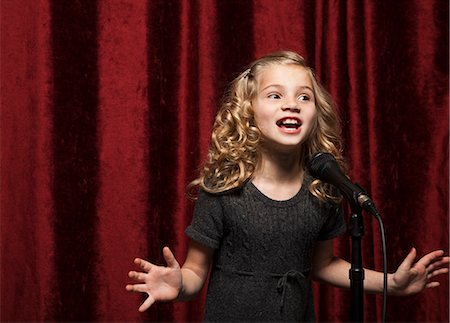 USA, Utah, Orem, Portrait of girl (8-9) singing with microphone Stock Photo - Premium Royalty-Free, Code: 640-06963192