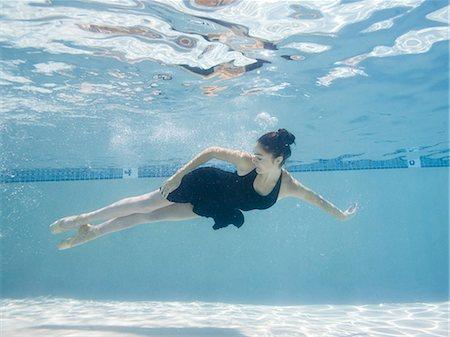 USA, Utah, Orem, Female ballet dancer under water Stock Photo - Premium Royalty-Free, Code: 640-06963243