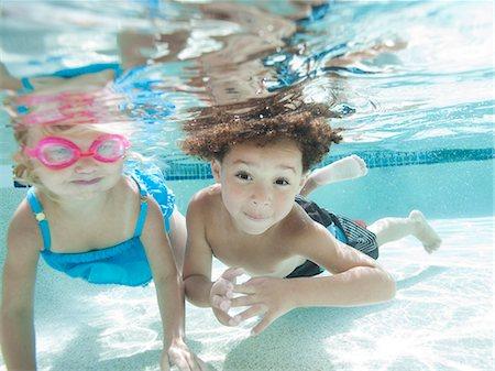 USA, Utah, Orem, Boy (4-5) and girl (2-3) swimming in pool Stock Photo - Premium Royalty-Free, Code: 640-06963368