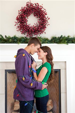 Smiling couple in room decorated for christmas Stock Photo - Premium Royalty-Free, Code: 640-06963404