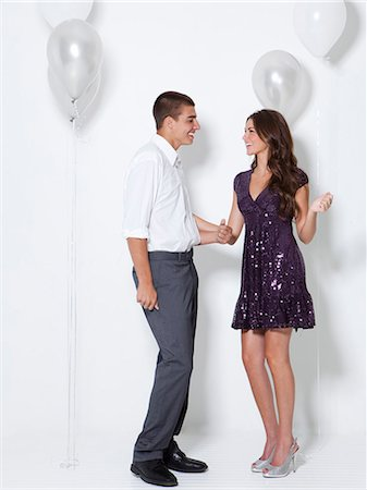 flirting - Young couple flirting at party Stock Photo - Premium Royalty-Free, Code: 640-06963495