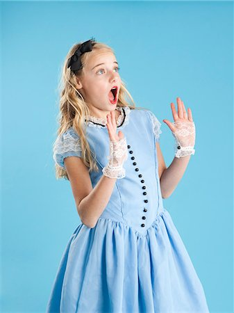 preteen open mouth - Girl (10-11) in Alice in Wonderland costume for Halloween Stock Photo - Premium Royalty-Free, Code: 640-06963563