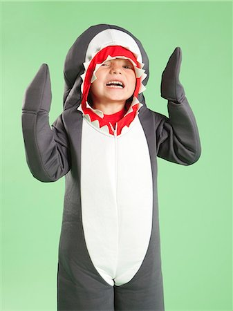 Portrait of boy (6-7) in shark costume for Halloween Stock Photo - Premium Royalty-Free, Code: 640-06963594
