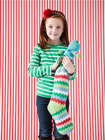 pantyhose kid - Studio portrait of girl (4-5) holding Christmas stocking Stock Photo - Premium Royalty-Free, Code: 640-06963699