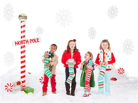 pantyhose kid - Group of kids (18-23months, 4-5,6-7) standing next to North Pole sign Stock Photo - Premium Royalty-Free, Code: 640-06963745