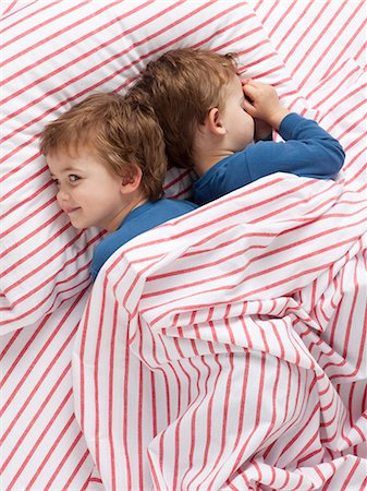 USA, Utah, Orem, Twin boys (2-3) wearing pajamas lying on bed Stock Photo - Premium Royalty-Free, Code: 640-06963758