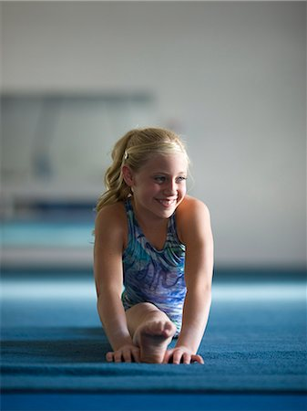 preteen girls stretching - USA, Utah, Orem, girl gymnast (10-11) performing splits Stock Photo - Premium Royalty-Free, Code: 640-08089044