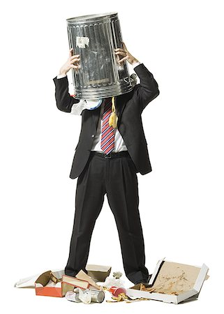 Businessman with trash can on head Stock Photo - Premium Royalty-Free, Code: 640-01348387