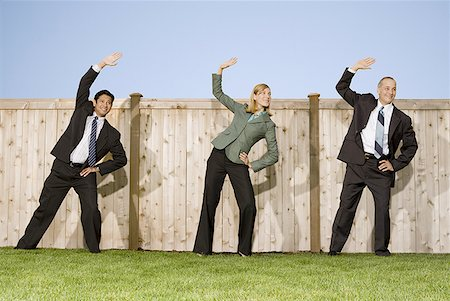 sweaty businessman - Low angle view of two businessmen and a businesswoman exercising Stock Photo - Premium Royalty-Free, Code: 640-01348542
