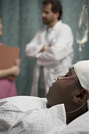 Close-up of a patient lying on his back Stock Photo - Premium Royalty-Free, Code: 640-01348634