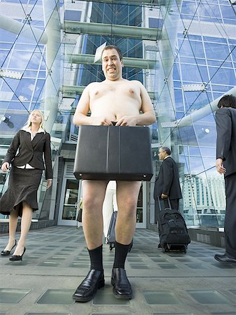 Low angle view of a naked man holding a briefcase Stock Photo - Premium Royalty-Free, Code: 640-01348707