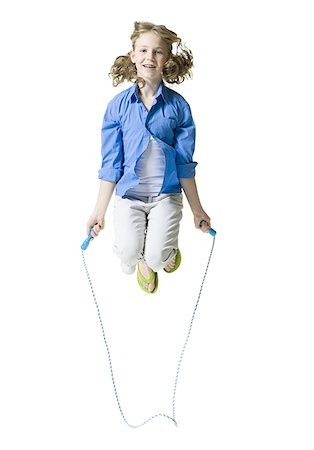 female white background full body - Portrait of a girl jumping rope Stock Photo - Premium Royalty-Free, Code: 640-01348964