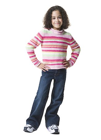 Portrait of a girl smiling and standing Stock Photo - Premium Royalty-Free, Code: 640-01349096