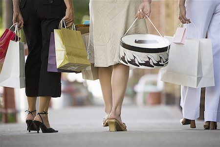 female rear end - Low section view of three women walking on a sidewalk Stock Photo - Premium Royalty-Free, Code: 640-01349174