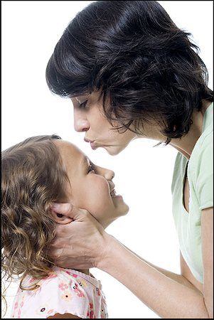preteen kissing - Close-up of a mid adult woman kissing her daughter's forehead Stock Photo - Premium Royalty-Free, Code: 640-01349396