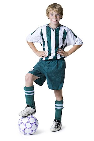 preteen  smile  one  alone - Portrait of a boy with his foot on a soccer ball Stock Photo - Premium Royalty-Free, Code: 640-01349474