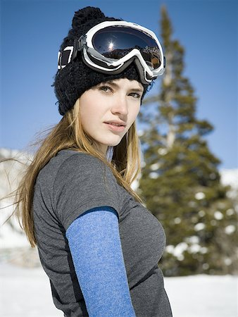 Profile of a young woman wearing ski goggles Stock Photo - Premium Royalty-Free, Code: 640-01349568