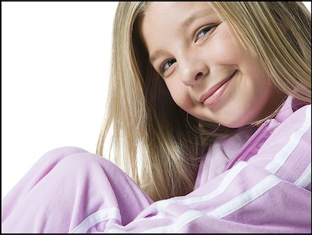 Close-up of a teenage girl smiling Stock Photo - Premium Royalty-Free, Code: 640-01349659