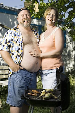 Overweight couple in a trailer park Stock Photo - Premium Royalty-Free, Code: 640-01349971
