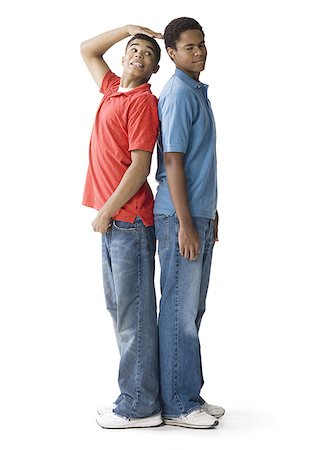 Profile of a teenage boy and a young man standing back to back Stock Photo - Premium Royalty-Free, Code: 640-01354028