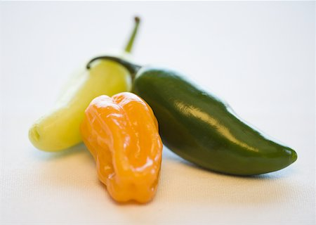 pimento - Close-up of a chili pepper and jalapenos Stock Photo - Premium Royalty-Free, Code: 640-01354032