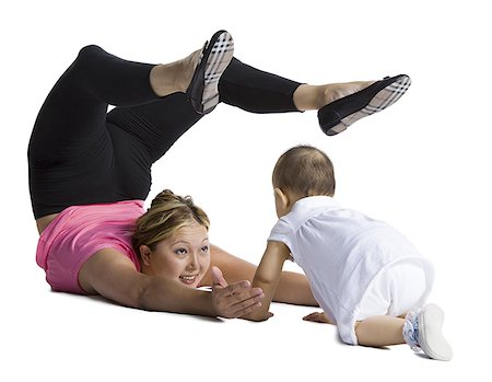 Contortionist mother with baby daughter Stock Photo - Premium Royalty-Free, Code: 640-01354116