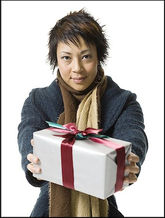 Portrait of a young woman holding a gift Stock Photo - Premium Royalty-Free, Code: 640-01354399