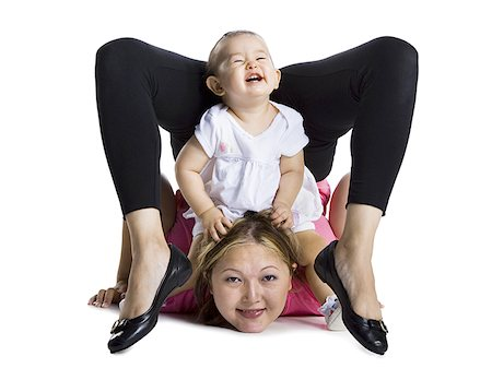Contortionist mother with baby daughter Stock Photo - Premium Royalty-Free, Code: 640-01354726