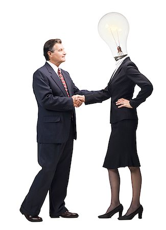 female silhouette head and hand - Businesswoman with light bulb instead of head shaking hands with mature businessman Stock Photo - Premium Royalty-Free, Code: 640-01355003