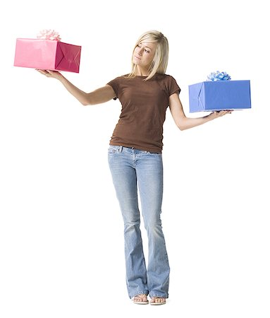 Portrait of a young woman holding gifts Stock Photo - Premium Royalty-Free, Code: 640-01355369